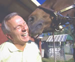 Daughter Julia's horse Dillon gives Capozzi an affectionate nuzzle.