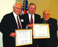 State Bar President John Van de Kamp (center), presented certificates acknowledging 50 years of bar membership to Seymour M. Rose (left) and Mortimer Herzstein.
