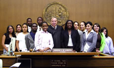Los Angeles Superior Court Judge Joseph Di Loreto stands with members of the Littles in Law program after they argued a slip-and-fall case in a mock trial.