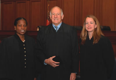 Joann Remke (right) was sworn in as presiding judge of the State Bar Court by Chief Justice Ronald George and Pat McElroy (left) was sworn in for another term as hearing judge.